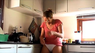 Naughty housewife gets naked and masturbates in the kitchen