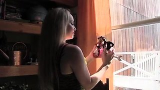 Stacked blonde fucks her lesbian slave with a strap-on toy