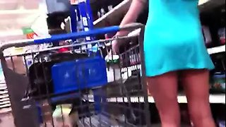 Slender amateur brunette with sexy legs upskirt in public