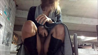Alluring teen fucks herself with a dildo in a public place