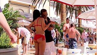 Party voyeur finds a slender brunette in a sexy red bikini