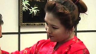 Two smoking hot Asian girls share a schlong