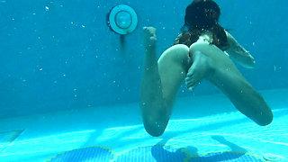 Small teen Mia Ferrari strips naked in pool