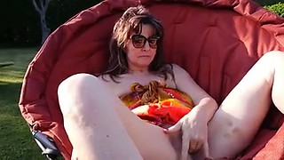 Lovely a bit pale sunbathing brunette MILF of mine fingered outdoors