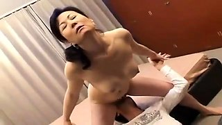 Horny Japanese housewife has a young man plowing her pussy