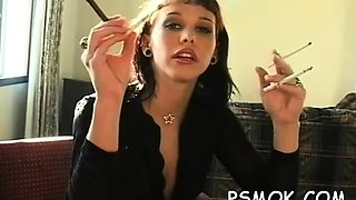 Playgirl in sexy lingerie loves to tease whilst smoking