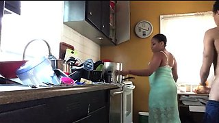 Curvaceous ebony wife gets drilled doggystyle in the kitchen