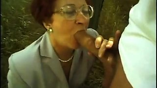 Horny redhead granny feeds her lust for cock in the woods