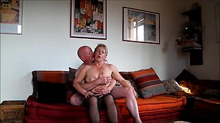 Luscious mature blonde in stockings cums hard on a meat pole