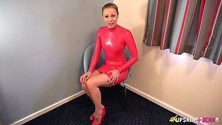 Torrid latex queen exposes her bum and inviting shaved pussy