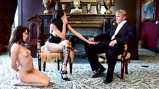 Dominatrix and her lover using young slave