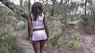 Amateur ebony babe in white lingerie stripping in nature