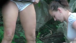 Women desperately unload their bladders in the woods