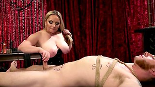 Aiden Starr strokes Sebastian Keys's cock while being tied.