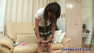 Naughty Asian chick Yuri Takao shows off her hairy pussy stuffed with sperm