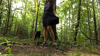 Young woman walks around naked in a forest and masturbates by a trail