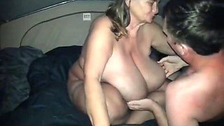 Huge breasted mature Sarah gives head