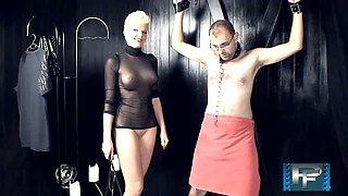 Sexy mistress is punishing tied up dude-slave