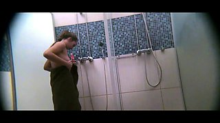 Voyeur spies on a beautiful young brunette taking a shower