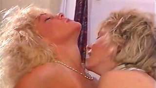 These two sexy blonde MILFs lick and tease each other