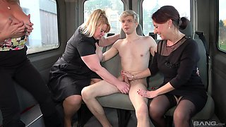 Matures share young lad's cock in the bang bus