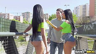 Two bootylicious and busty Latin babes are fucked by one lucky dude