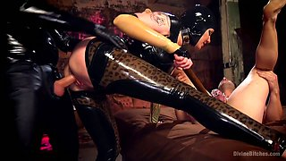 Mistress in latex costume Madeline Marlowe punishes two kinky dudes
