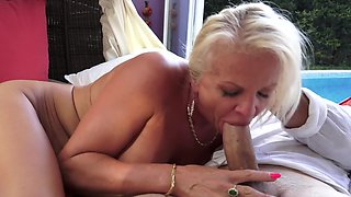 A granny with blonde hair is by the pool, getting her wet pussy rammed