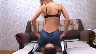 Russian thin mistress sit on slave face in jeans. Facesitting femdom.