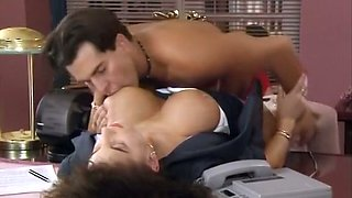 Sensational brunette busty businesswoman fucked in the office