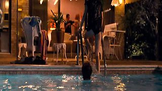 Kristen Stewart looking hot while swimming in the pool,