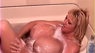 massive-breasted Mommy smoking in the bath