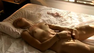 Dazzling blonde with small tits fingers herself to pleasure