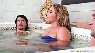 busty eva jacks him off in the hot tub
