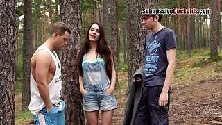 Naughty brunette is enjoying while cuckolding her boyfriend in the local forest, during the day