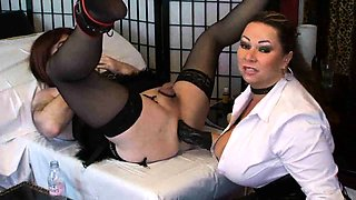 Kinky crossdresser has a stacked dominatrix fisting his ass