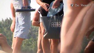 Beach spy voyeur guy enjoys amateur girls nude while rest