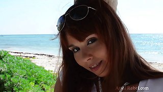 Ariel Rebel on the public beach stripping and pleasuring her slit