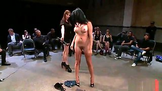 Brunette bitch does striptease in front of people