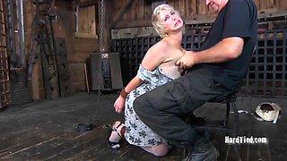 Blonde sex slave treated to her master's erected boner