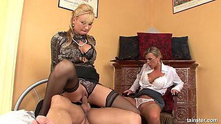 Two horny businesswomen are about to do some wild cock riding