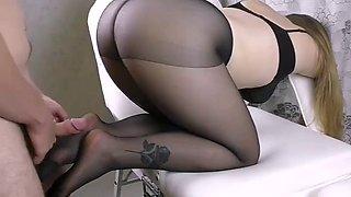 Ar in black pantyhose foothandjob