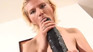 Vixen practices her skills on a monster dildo