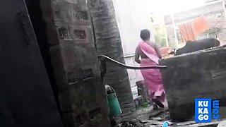 Voyeur - Indian BBW bathes outside