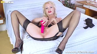 Horny blonde wanks pink sex toy in retro nylon garters heels