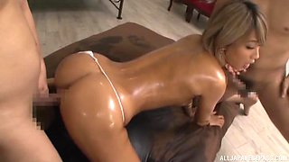 Oiled up Japanese babe Aika pounded and creamed by two cocks