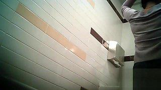 Women pee in public toilet 2414