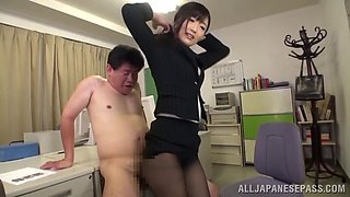 An aroused Japanese office girl gives his boss a hot footjob in a POV shoot
