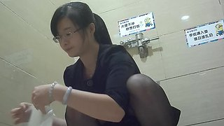 Chinese office milf lady pissing in the toilet