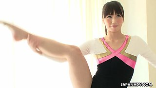 Flexible and busty gymnast is toying her bush with a club.